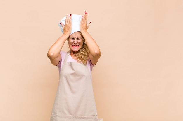 Middle age woman baker feeling stressed and anxious