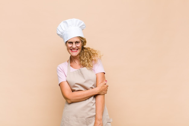 恥ずかしがり屋で元気に笑う中年女性パン屋、フレンドリーで前向きだが不安な態度