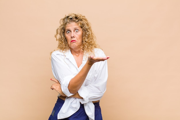 Middle age woman feeling confused and clueless, wondering about a doubtful explanation or thought