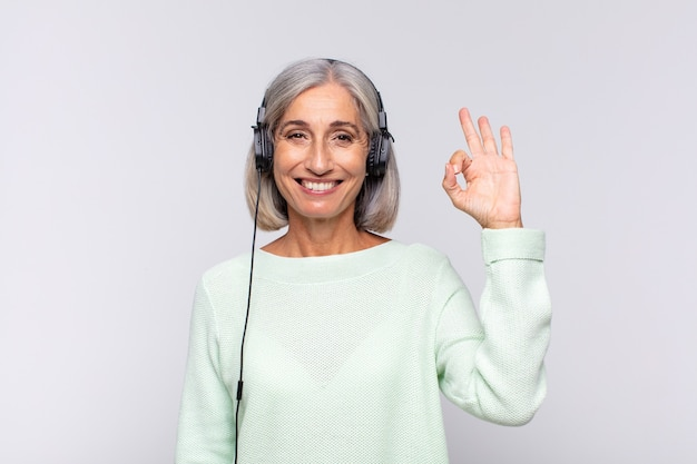 Middle age woman feeling happy, relaxed and satisfied isolated