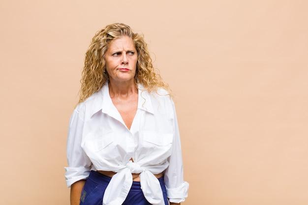Middle age woman feeling sad, upset
