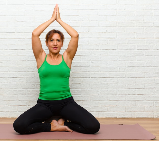Middle age woman practicing yoga