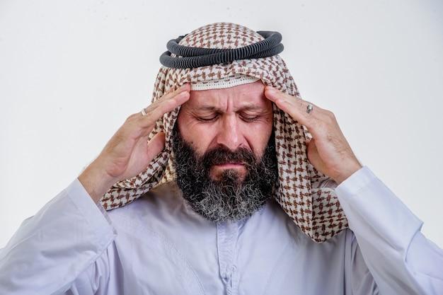 Middle aged arab man having headache