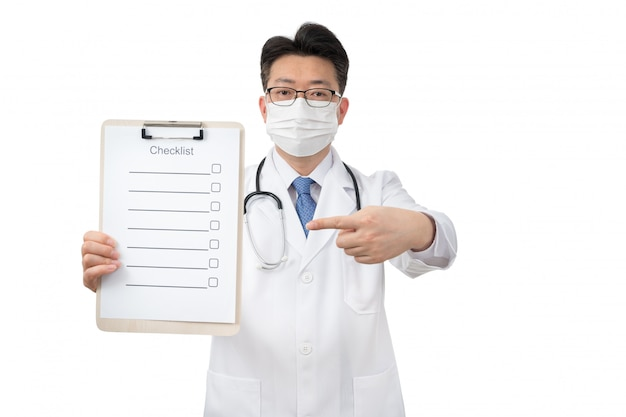 Middle-aged asian doctor holding clipboard on white