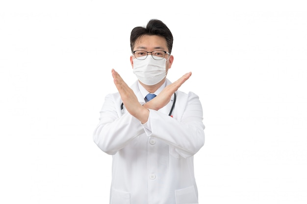 Middle-aged asian man wearing a disposable mask showing denial sign