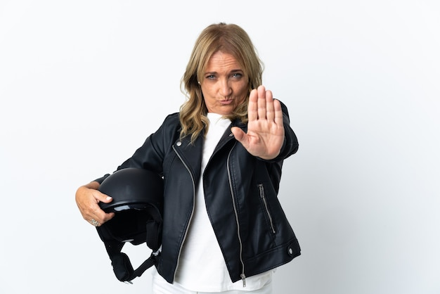 Middle aged biker over isolated white background making stop gesture