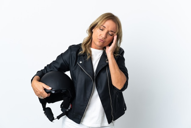 Middle aged biker over isolated white background with headache
