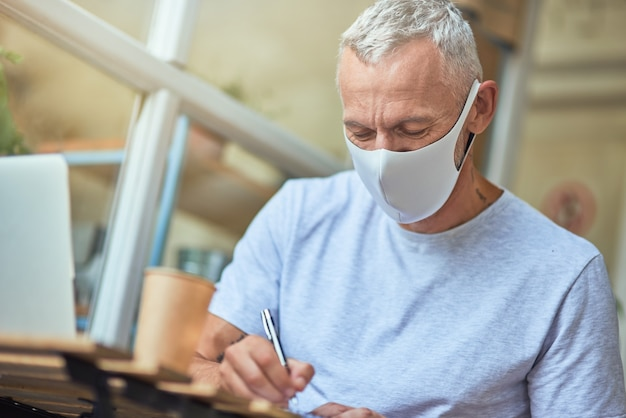Middle aged caucasian man in protective mask