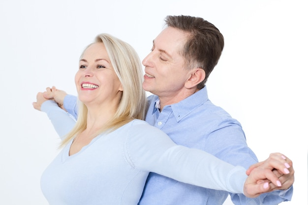 Middle aged couple in an embrace portrait isolated on white.