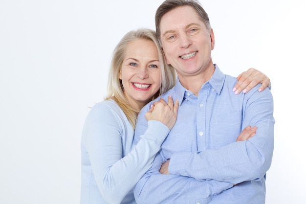 Middle aged couple in an embrace portrait.
