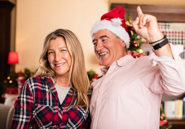 Middle aged couple having fun on christmas