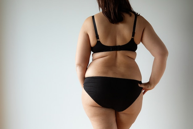 Middle aged curvy woman body view from the back