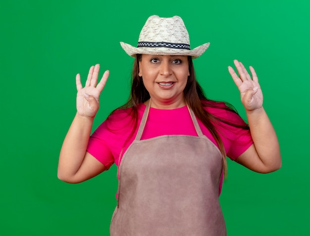 Middle aged gardener woman in apron and hat