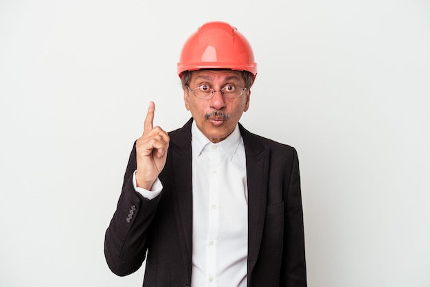 Middle aged indian architect man isolated on white background having some great idea, concept of creativity.