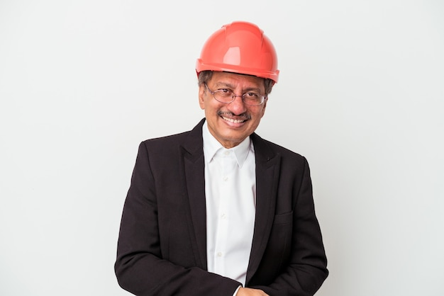 Middle aged indian architect man isolated on white background laughing and having fun.