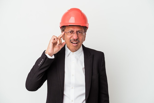 Middle aged indian architect man isolated on white background showing a disappointment gesture with forefinger.
