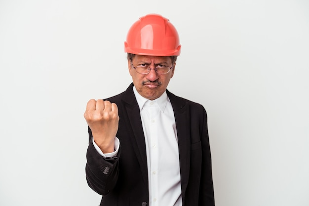 Middle aged indian architect man isolated on white background showing fist to camera, aggressive facial expression.