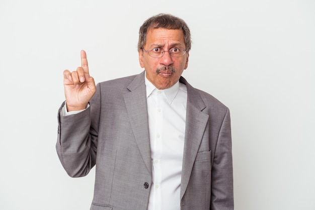 Middle aged indian business man isolated on white background having some great idea, concept of creativity.