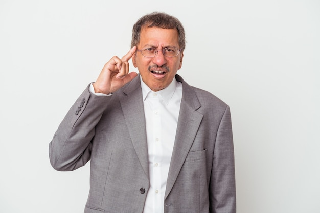 Middle aged indian business man isolated on white background showing a disappointment gesture with forefinger.