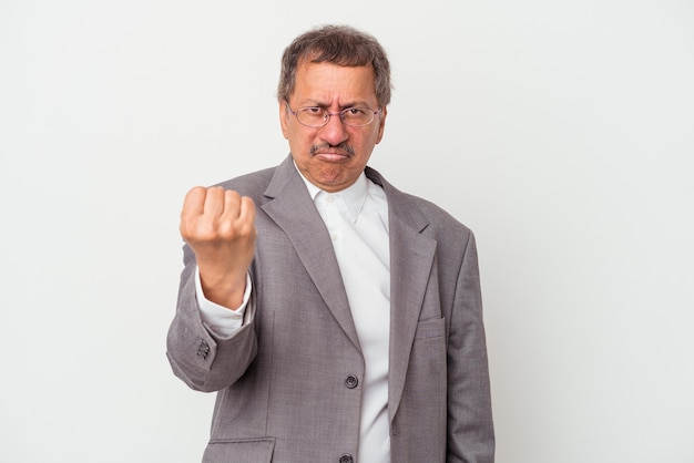 Middle aged indian business man isolated on white background showing fist to camera, aggressive facial expression.