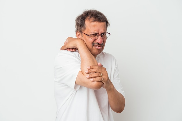 Middle aged indian man isolated on white background having a neck pain due to stress, massaging and touching it with hand.