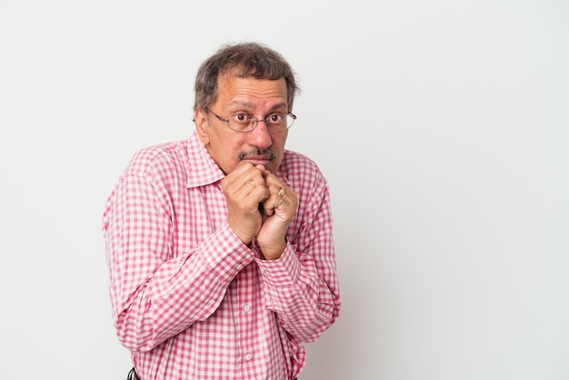 Middle aged indian man isolated on white background scared and afraid.