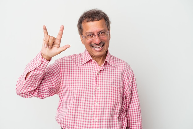 Middle aged indian man isolated on white background showing a horns gesture as a revolution concept.