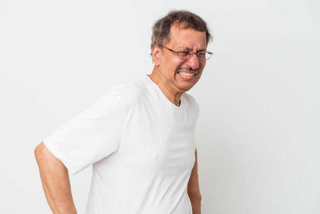 Middle aged indian man isolated on white background suffering a back pain.