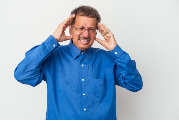 Middle aged indian man isolated on white background touching temples and having headache.
