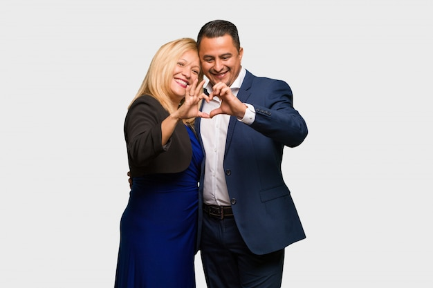 Middle aged latin couple celebrating valentines day