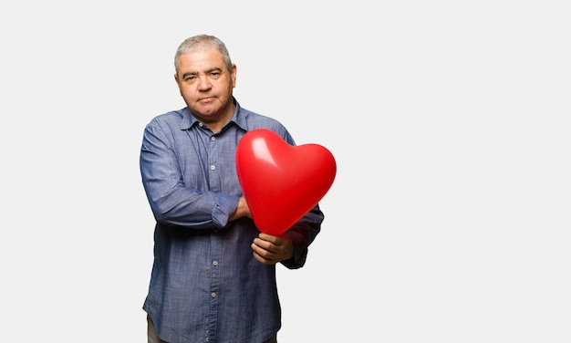 Middle aged man celebrating valentines day looking straight ahead