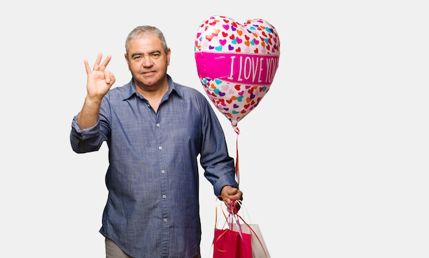 Middle aged man celebrating valentines day showing number three