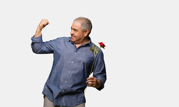 Middle aged man celebrating valentines day who does not surrender