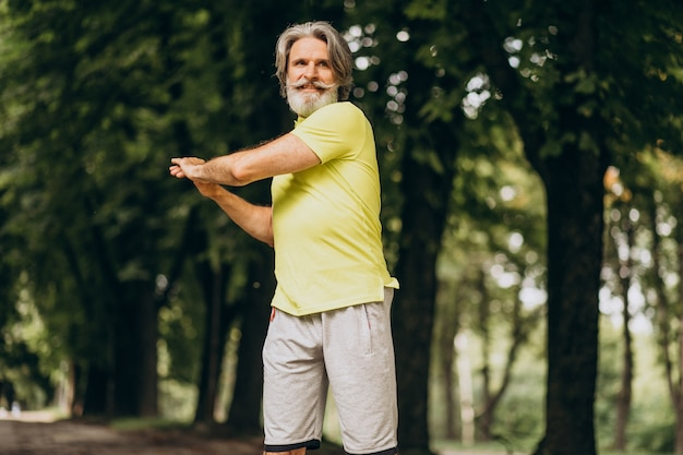 Middle aged man jogging in forest