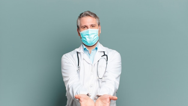 Middle aged man physician with a protective mask