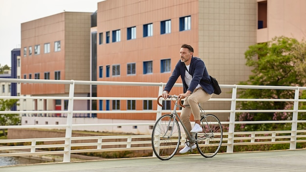A middle aged man riding a bike