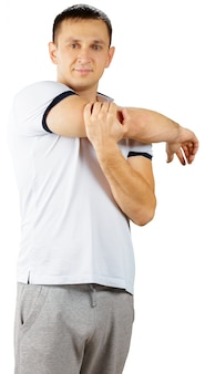 Middle-aged man in sporty outfit doing exercises isolated on white