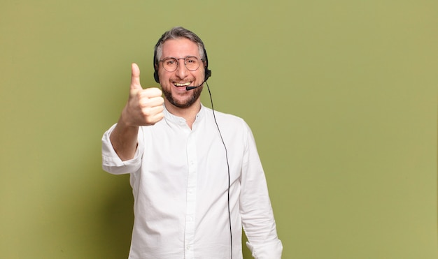 Middle aged man with headset giving thumb up