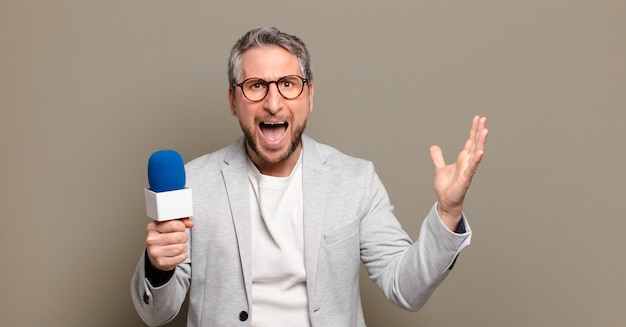 Middle aged presenter man