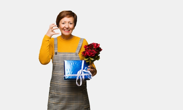 Middle aged woman celebrating valentines day angry and upset