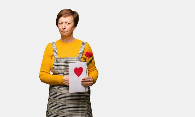 Middle aged woman celebrating valentines day thinking about an idea