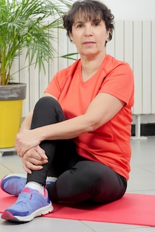 Middle-aged woman doing fitness exercises