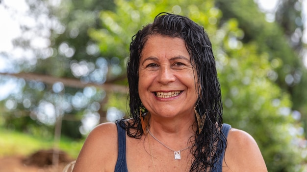 Middle aged woman looking at camera with happy smile