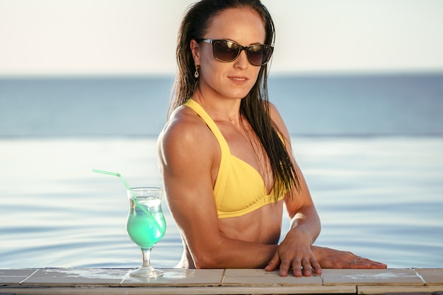 Middle-aged woman relaxing in swimming pool water