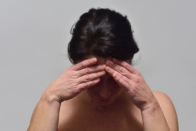 Middle-aged woman with headache
