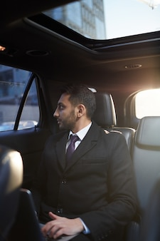 Middle-eastern businessman in expensive car