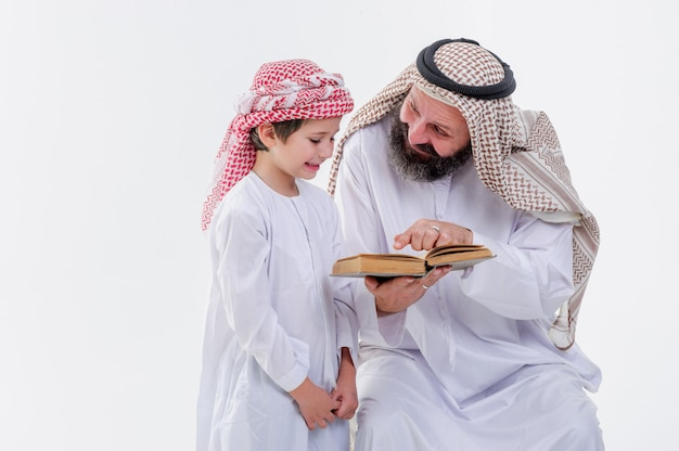 Middle eastern father teaching his son