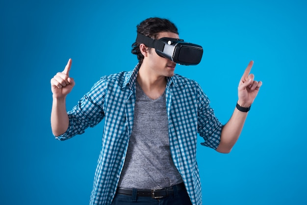 Middle eastern man in virtual reality isolated.