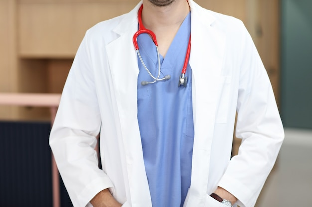 Midsection of doctor in uniform in hospital