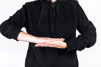 Midsection view of a person making hand sign